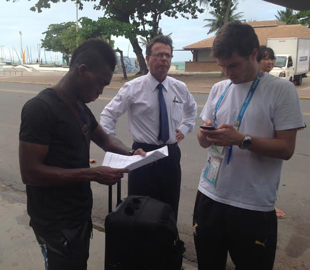 Christian Atsu going through his travel documents.