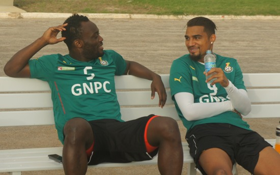 Michael Essien and Kevin-Prince Boateng having a laugh at the Black Stars training grounds