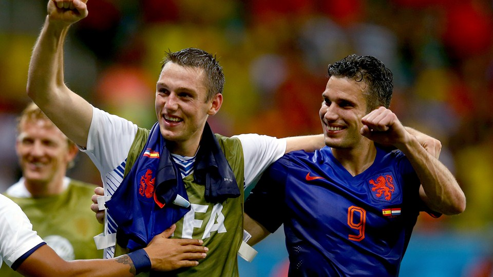 Robin van Persie of the Netherlands (R) celebrates with Stefan de Vrij of the Netherlands following the 2014 FIFA World Cup Brazil Group B match between Spain and Netherlands at Arena Fonte Nova on June 13, 2014 in Salvador, Brazil. (Photo by Alex Grimm - FIFA/FIFA via Getty Images)