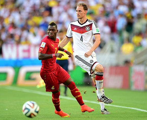 Germany's Benedikt Howedes (right) and Ghana's Christian Atsu battle for the ball