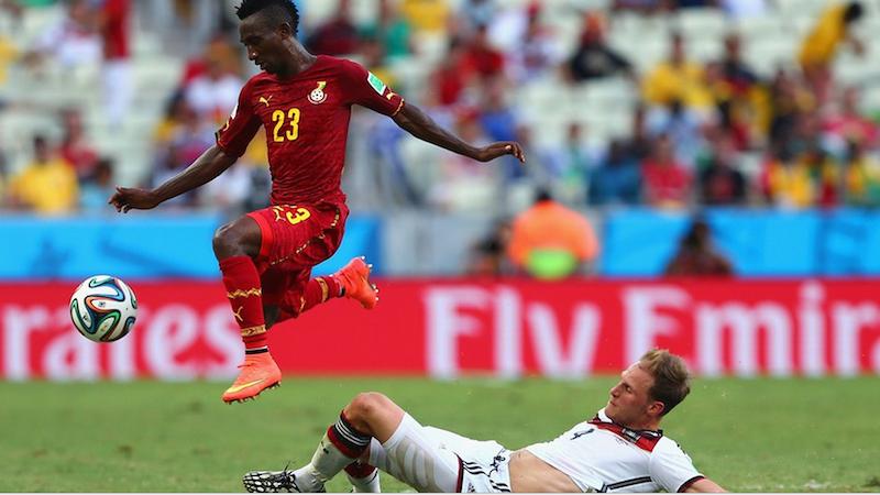 Harrison Afful in full flight for Ghana against Germany.