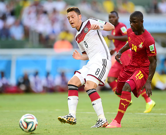 Germany's Mesut Ozil (left) wins the ball ahead of Ghana's Jonathan Mensah