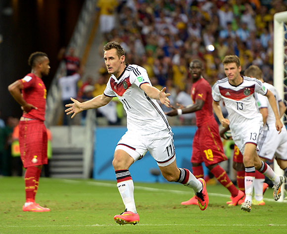 Germany's Miroslav Klose (left) celebrates scoring their second goal