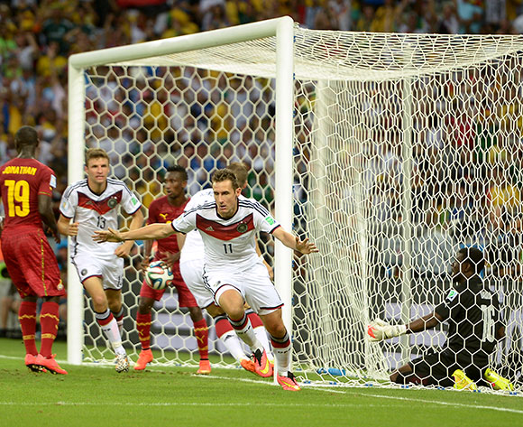 Germany's Miroslav Klose (left) celebrates scoring their second goal with teammate Thomas Muller