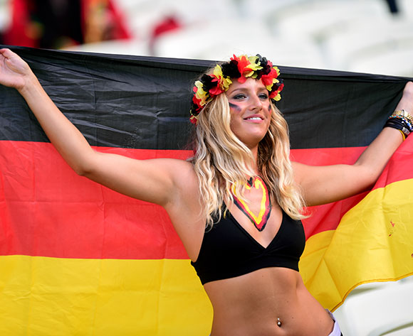 A Germany fan soaks up the atmosphere at the Estadio Castelao prior to the game