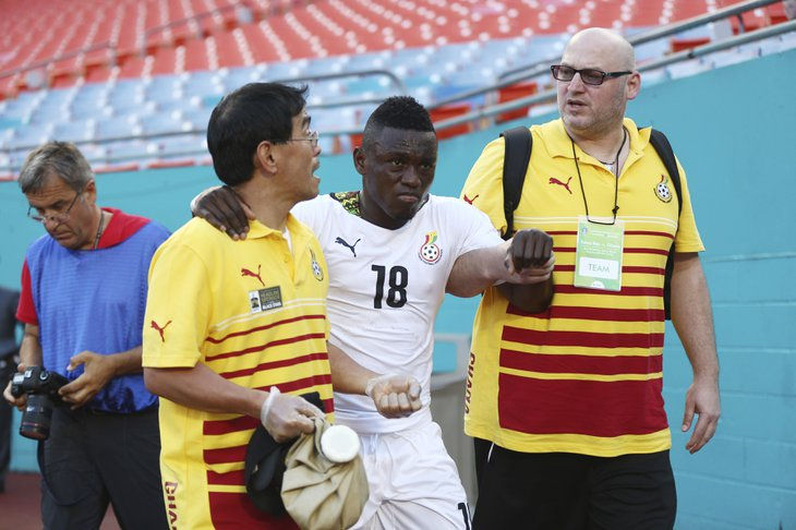 Abdul Majeed Waris hobbling into the dressing room.