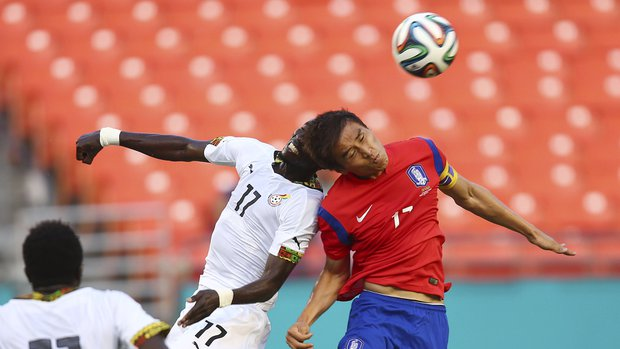 Ghana' Mohammed Rabiu (17) and South Korea's Jacheol Koo (17) fight for the ball during the first half of an international friendly soccer match in Miami Gardens, Fla., Monday, June 9, 2014. ( AP Photo/J Pat Carter)