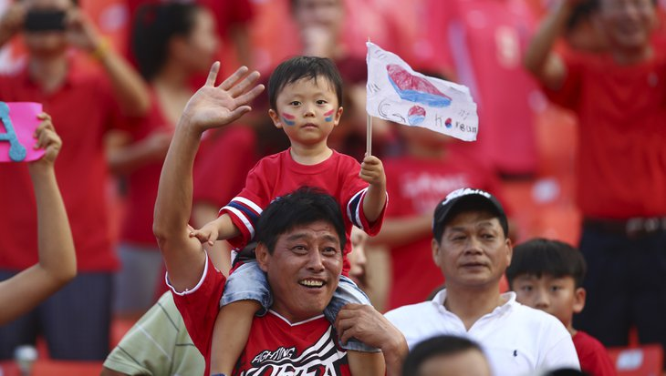 Soccer fans cheer for the Korean National team as it plays Ghana during the first half of an international friendly soccer match in Miami Gardens, Fla., Monday, June 9, 2014. ( AP Photo/J Pat Carter)