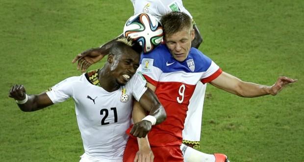 Ghana defender John Boye in an aerial challenge