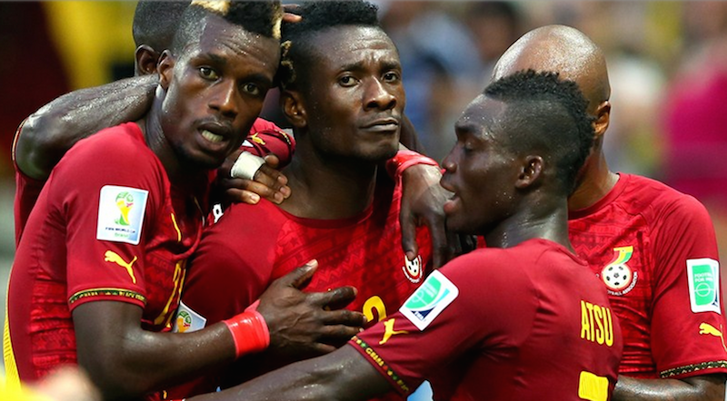 Asamoah Gyan and teammates celebrate.