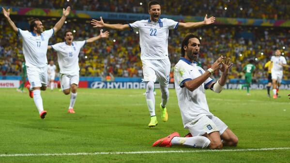 Greece players celebrating their round of 16 qualification.