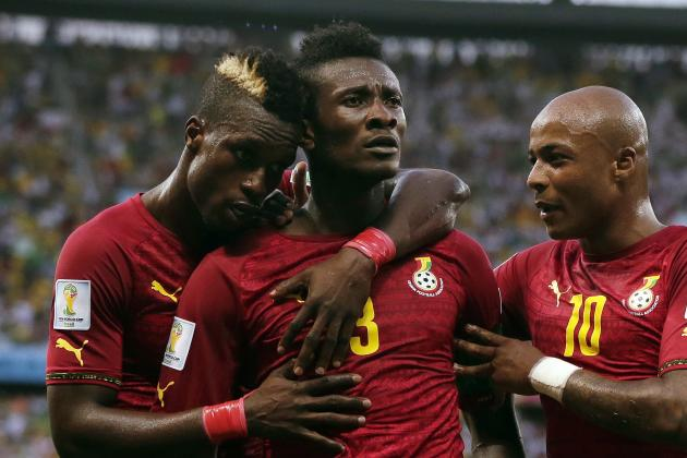 Asamoah Gyan, centre, celebrates scoring Ghana's second goal during their 2-2 draw with Germany.