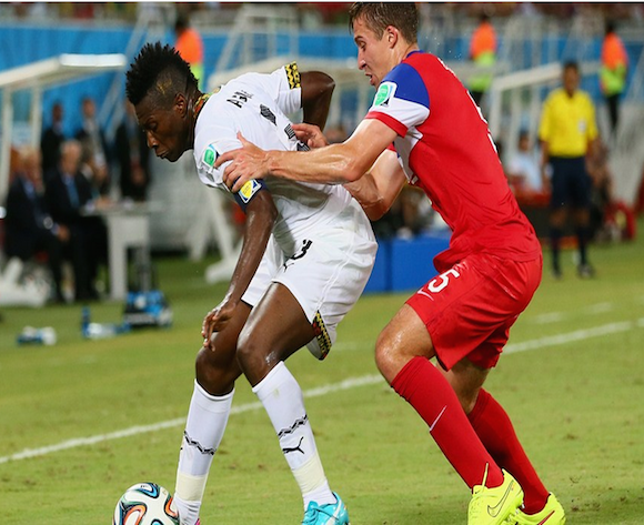 Asamoah Gyan of Ghana and Matt Besler of the United States battle for the ball during the 2014 FIFA World Cup Brazil Group G match between Ghana and the United States at Estadio das Dunas on June 16, 2014 in Natal, Brazil. (Photo by Kevin C. Cox/Getty Images)
