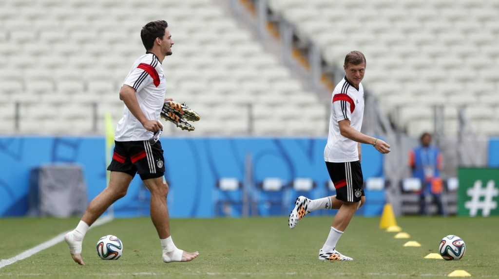 German national soccer players Mats Hummels, left, and Toni Kroos arrive for an official training session the day before the group G World Cup soccer match between Germany and Ghana at the Arena Castelao in Fortaleza, Brazil, Friday, June 20, 2014. (Matthias Schrader/Associated Press)