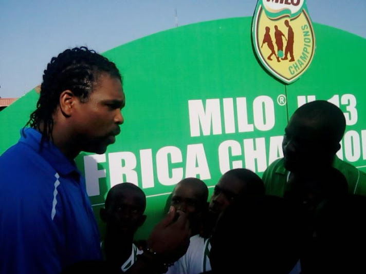 African football legend Kanu interacts with the kids after the event
