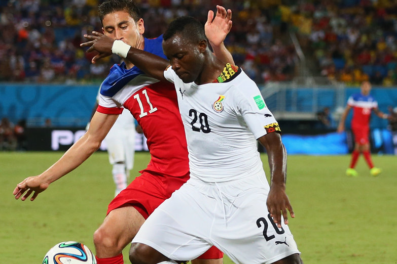 NATAL, BRAZIL - JUNE 16:  Kwadwo Asamoah of Ghana controls the ball against Alejandro Bedoya of the United States during the 2014 FIFA World Cup Brazil Group G match between Ghana and the United States at Estadio das Dunas on June 16, 2014 in Natal, Brazil.  (Photo by Kevin C. Cox/Getty Images)