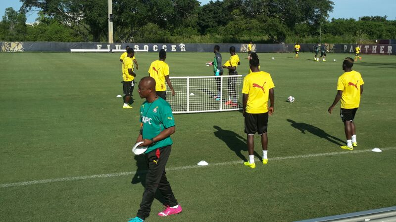 Kwesi Appiah setting cones for training.