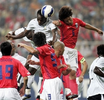 Michael Essien winning an aerial challange in a previous meeting with South Korea
