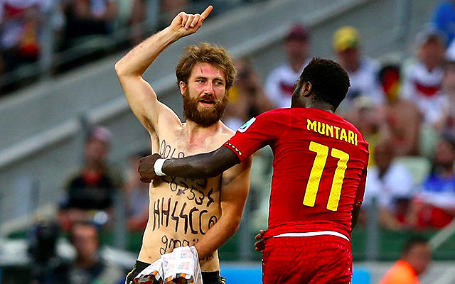 Sulley Muntari and pitch invader.