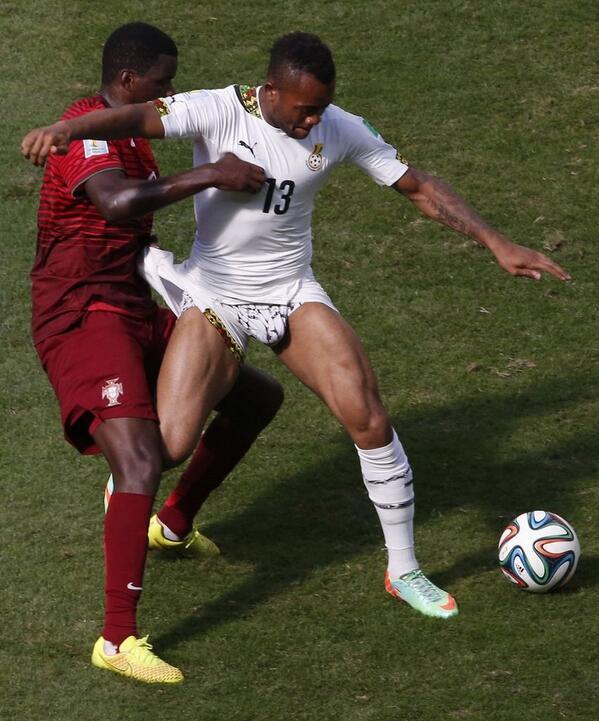 William Carvalho tackling Ghana striker Andre Ayew.