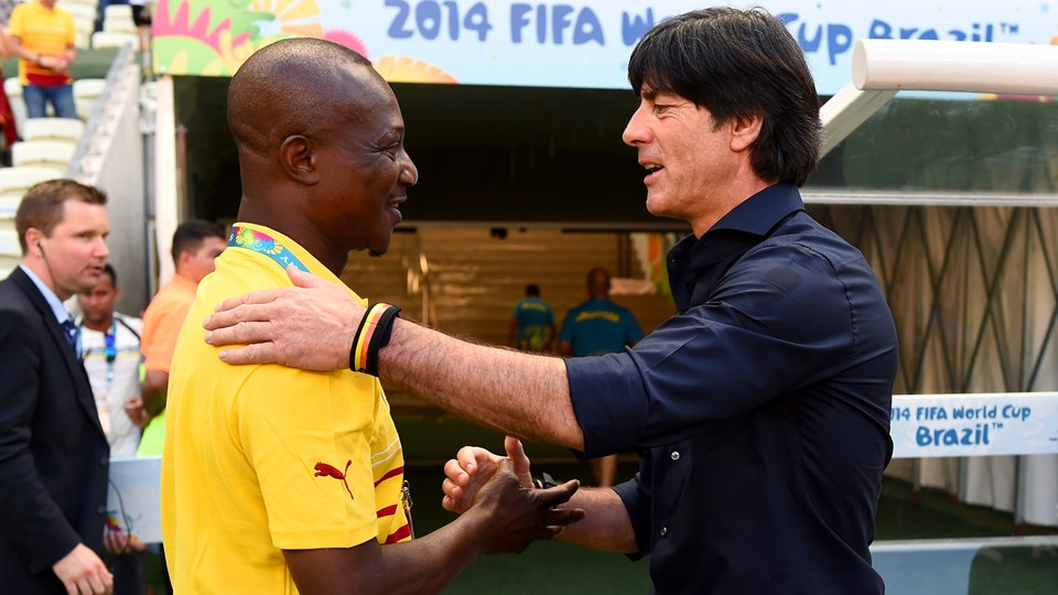 Ghana coach Kwesi Appiah exchanging pleasantries with his German opponent Joachim Low