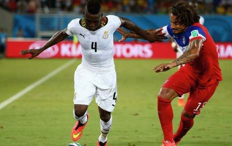 Daniel Opare shaking off a challenge from Jermaine Jones