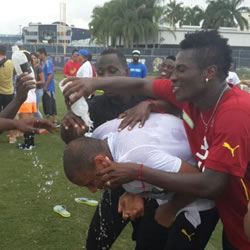 Ghana players initiated goalkeeper Adam Kwarasey as a new dad at their World Cup training camp in Miami by pouring water on him to welcome the birth of his first child.