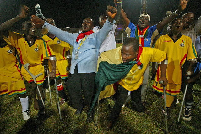 Ghana amputee soccer team celebrates winning the first amputee football championships held in Freetown, Sierra Leone, February 14, 2007. Ahmed Jallanzo/EPA