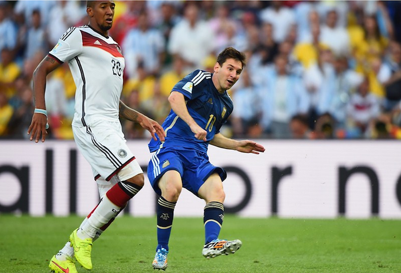 Jerome Boateng keeping an eye on Lionel Messi.