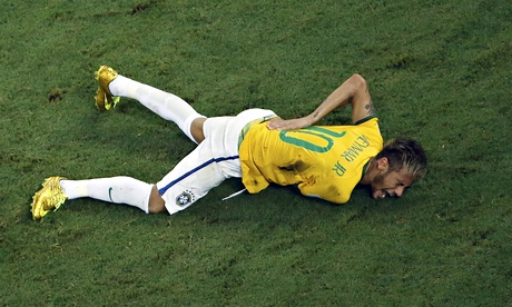 Brazil's Neymar grimaces in pain after a challenge by Colombia's Juan Zuniga put the striker out of the World Cup. Photograph: Fabrizio Bensch/Reuters