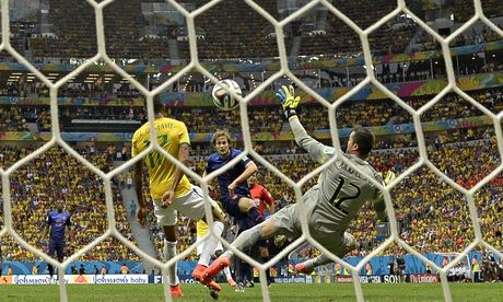 Daley Blind, centre, scores Holland's second goal during the World Cup third-place play-off against Brazil. Photograph: Fabrice Coffrini/AFP/Getty Images