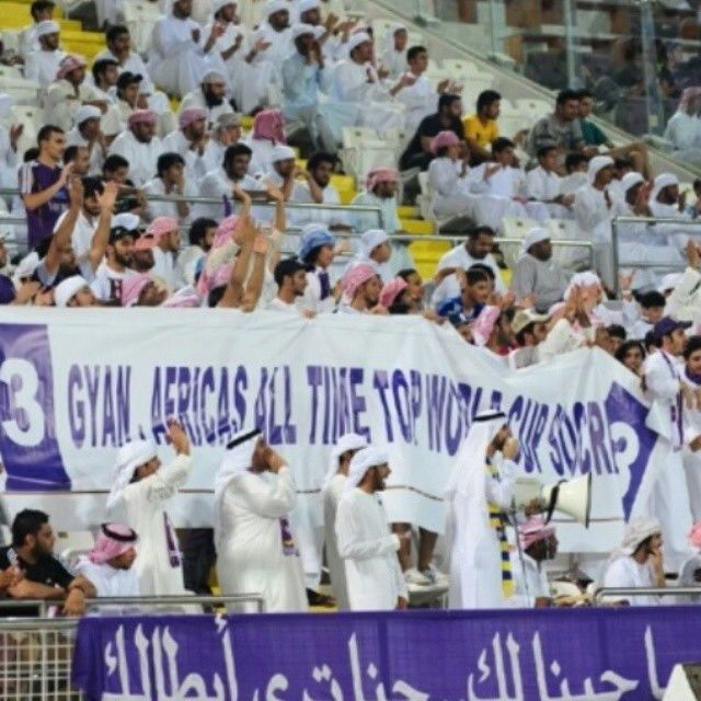 Al Ain fans holding up a banner of Asamoah Gyan's World Cup achievements