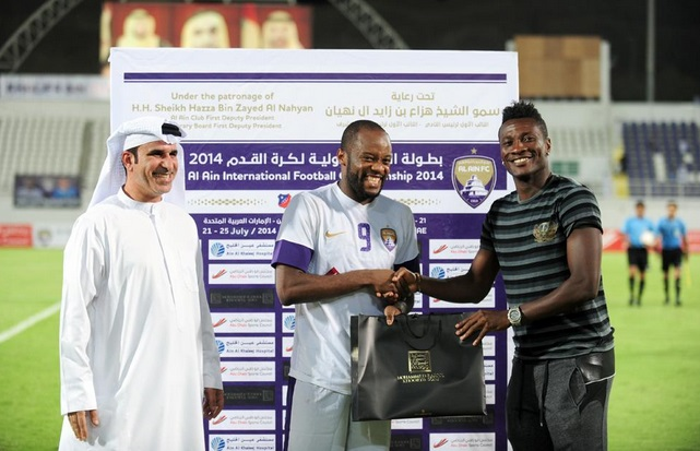 Ghana captain Asamoah Gyan, right, is delighted with new deal at Al Ain