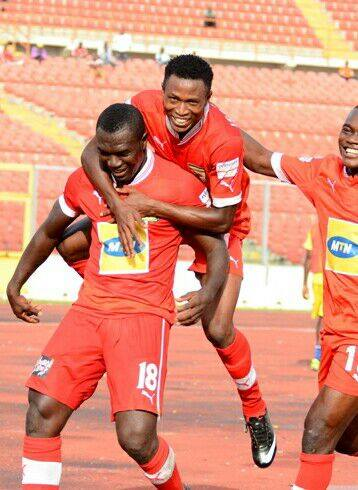 Issah Yakubu celebrating a goal with club legend Isaac Boakye has refused to sign a new club for Kotoko