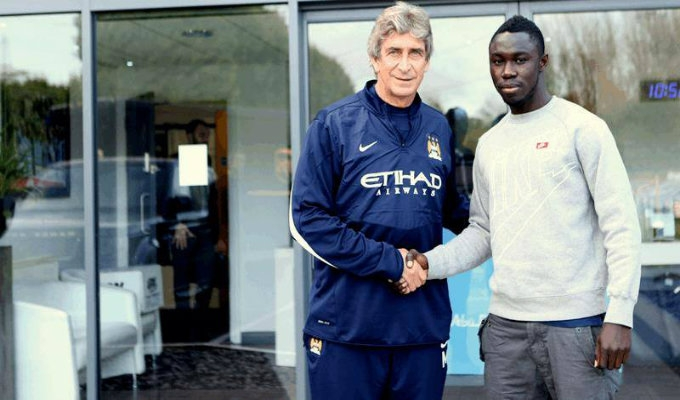 Nana Boateng, right with Manchester City manager Pellegrini, has returned from injury