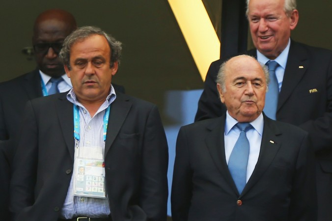 UEFA President Michel Platini (L) and FIFA President Joseph Blatter look on during the 2014 FIFA World Cup Brazil Group G match between Germany and Portugal at Arena Fonte Nova on June 16, 2014 in Salvador, Brazil.