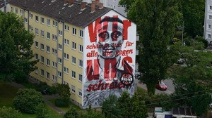 Striking message: Anthony Yeboah's anti-discrimination call from more than 20 years ago has been given a new lease of life on the side of this Frankfurt building