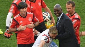 The diplomat's son Anthony Baffoe (right) jokes with Germany player Bastian Schweinsteiger.