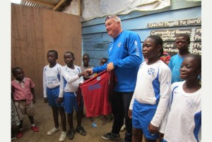 DONATION: William Tambling with the children in Ghana