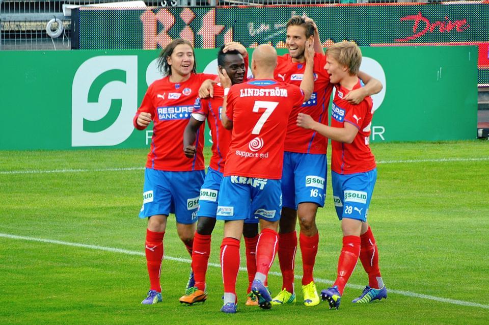 Accam celebrates with team-mates