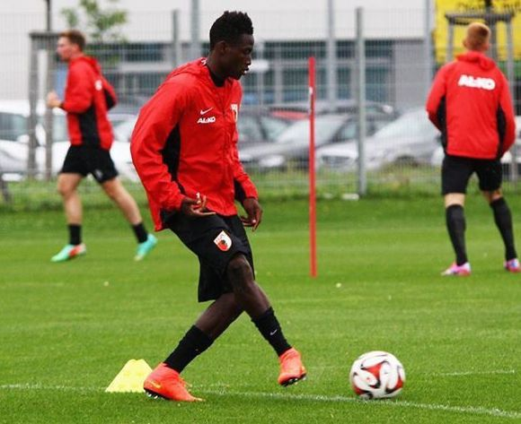 Baba Abdul Rahman kicking a ball in training with Augsburg.