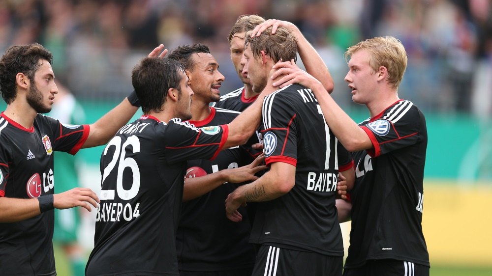 Bellarabi, middle, celebrates with his Leverkusen team-mates