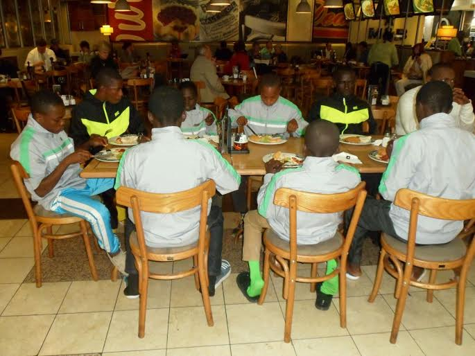 The Academy players having a meal