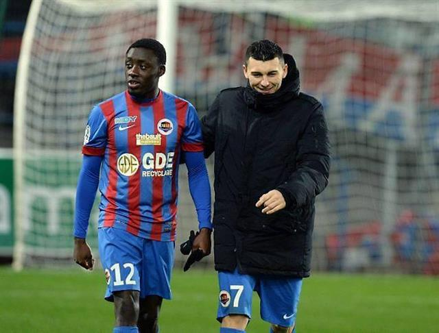 Dennis Appiah, left, was sent off during Caen's loss against Lille