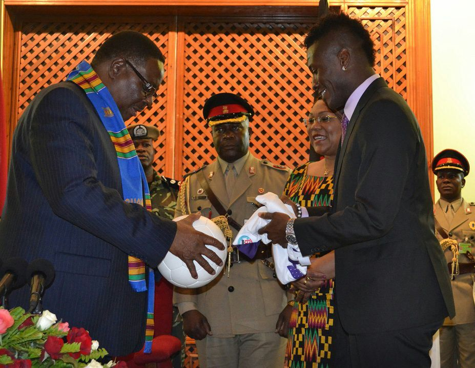 Ghana captain Asamoah Gyan doing the presentation to President Peter Mutharika