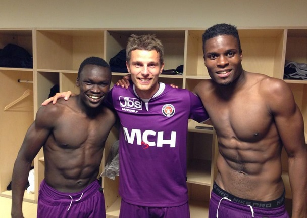 Ghana defender Francis Dickoh takes a shot with team-mates after win over Copenhagen