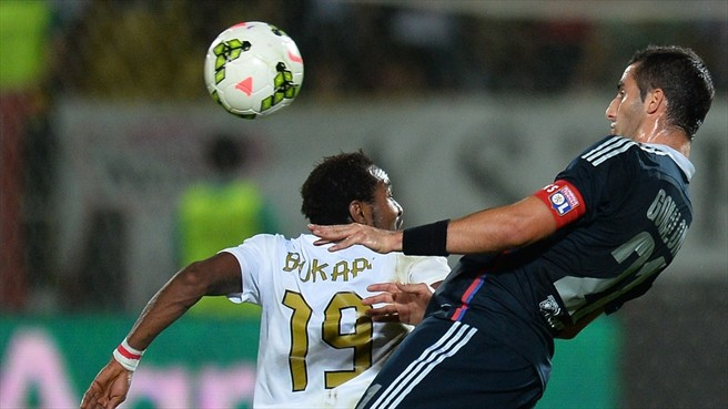 Ghana striker Sadat Bukari fights for the ball with Lyon's Maxime Gonalons during last night's game