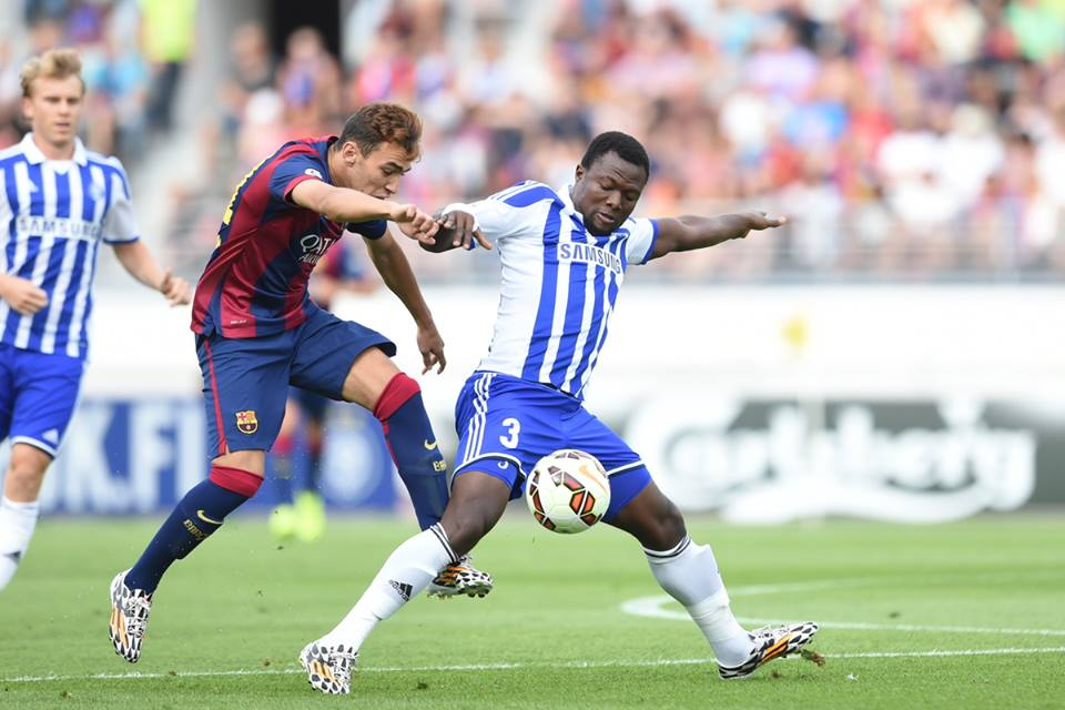 Gideon Baah in action against Barcelona