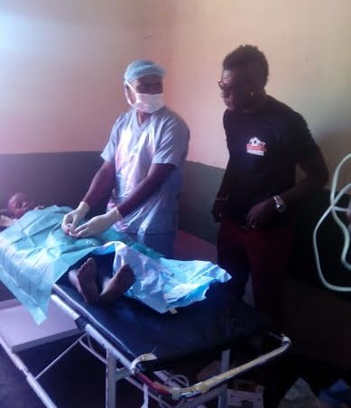 Asamoah Gyan took his turn to perform circumcision after brief tutorial