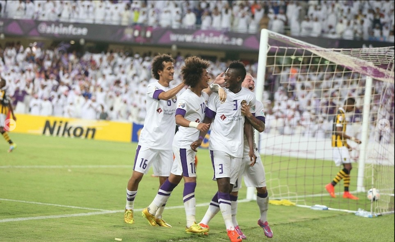 Asamoah Gyan celebrating with Ai Ain players